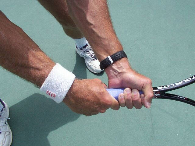 Two Handed Backhand Placement Of Both Hands